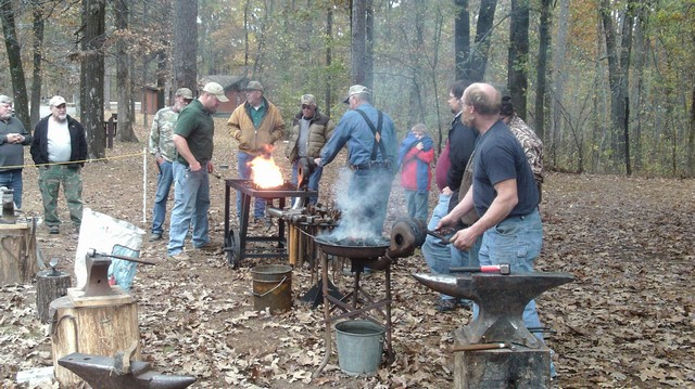 New member on the right is Carl Steyer, resident blacksmith at Parker Homestead in Harrisburg, AR.